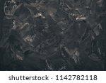 black stone background. top... | Shutterstock . vector #1142782118
