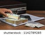 drug trafficker holding a lot... | Shutterstock . vector #1142789285