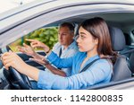 smiling woman learns to drive... | Shutterstock . vector #1142800835