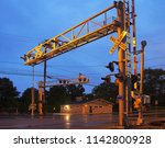 railroad crossing gates with...   Shutterstock . vector #1142800928