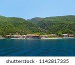 monastery buildings on shore of ... | Shutterstock . vector #1142817335