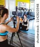 athlete blogger making a video   Shutterstock . vector #1142823548