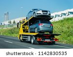 cars carrier on the road. truck ... | Shutterstock . vector #1142830535