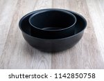 black tableware on the table | Shutterstock . vector #1142850758