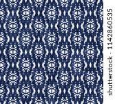 folk ornamental grid indigo... | Shutterstock . vector #1142860535