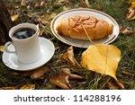Autumn scene. Coffee and croissant. beautiful day - stock photo