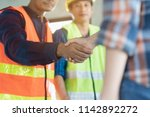 construction worker and... | Shutterstock . vector #1142892272