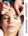 eyelash extension procedure....   Shutterstock . vector #1142943392