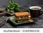 square sandwich with chicken... | Shutterstock . vector #1142960132