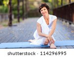 fit middle aged woman relaxing... | Shutterstock . vector #114296995