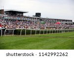 Small photo of A huge crowd pack into the stands at Market Rasen Races Ladies Day : Market Rasen Racecourse, Lincolnshire, UK : 21 July 2018 : Pic Mick Atkins
