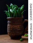 a lot of long green asparagus... | Shutterstock . vector #1143005492