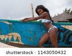 attractive ebony bikini model... | Shutterstock . vector #1143050432