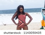 attractive ebony bikini model... | Shutterstock . vector #1143050435