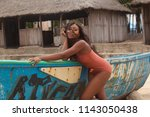 attractive ebony bikini model... | Shutterstock . vector #1143050438