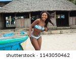 attractive ebony bikini model... | Shutterstock . vector #1143050462