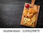 fried chicken with french fries ...   Shutterstock . vector #1143129875