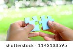 hands trying to connect couple... | Shutterstock . vector #1143133595