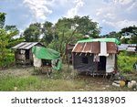 Wood And Tin Huts In Small...