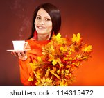 Woman holding  cup of coffee and orange leaves. - stock photo
