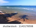 crystal clear waters and shade... | Shutterstock . vector #1143178508