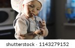 a funny kid eats a chocolate... | Shutterstock . vector #1143279152