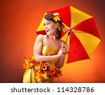 Woman with autumn hairstyle and umbrella. Fashion glamour. - stock photo
