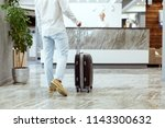 man at hotel reception. | Shutterstock . vector #1143300632