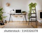 lamp and desktop computer on... | Shutterstock . vector #1143326378