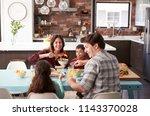 family enjoying meal around... | Shutterstock . vector #1143370028
