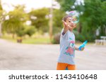 adorable little boy having fun... | Shutterstock . vector #1143410648