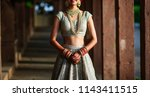 asian bridal showing gold... | Shutterstock . vector #1143411515