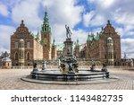 Small photo of HILLEROD, DENMARK - JUNE 23, 2017: Frederiksborg Castle (Frederiksborg Slot, XVII century). Neptune Fountain (1622).