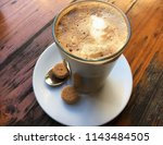 latte macchiato with foam in... | Shutterstock . vector #1143484505