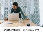 young woman making notes while...   Shutterstock . vector #1143539495