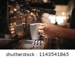 close up of barista holding a... | Shutterstock . vector #1143541865
