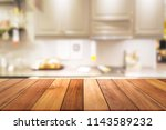 empty wooden table and blurred... | Shutterstock . vector #1143589232