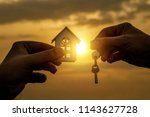 hand transfers the key and the... | Shutterstock . vector #1143627728
