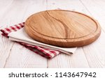 napkin and board for pizza on... | Shutterstock . vector #1143647942