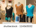 Color blouses on mannequins in mall - stock photo