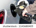car refueling diesel pump at... | Shutterstock . vector #1143680405