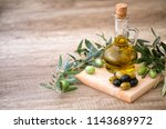 green and black olives with... | Shutterstock . vector #1143689972