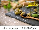green and black healthy olive... | Shutterstock . vector #1143689975