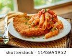 german chicken schnitzel with...   Shutterstock . vector #1143691952