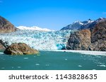 south sawyer glacier at the end ... | Shutterstock . vector #1143828635