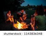 group of friends enjoying music ... | Shutterstock . vector #1143836348