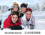 two couples laying in the snow | Shutterstock . vector #114385888