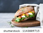 sandwich from a cereal baguette ... | Shutterstock . vector #1143889715