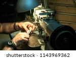 leather tailor man hands making ... | Shutterstock . vector #1143969362