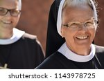 smile elderly nun in... | Shutterstock . vector #1143978725